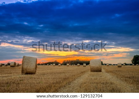 End of day over field with hay bale in Hungary- This photo make HDR
