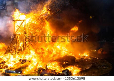 End of the Valencian festivities of Fallas, Monument faller consumed in the fire in high flares. #1353613598