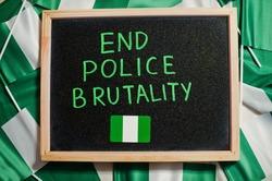 End police brutality. Inscription of nigerian protest slogan.