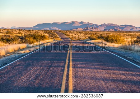 endless asphalt road with blue sky in Big Bend National Park, Texas, USA