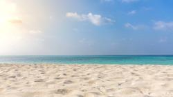 Endless beach scene, calm summer nature landscape. Blue sky and soft ocean waves