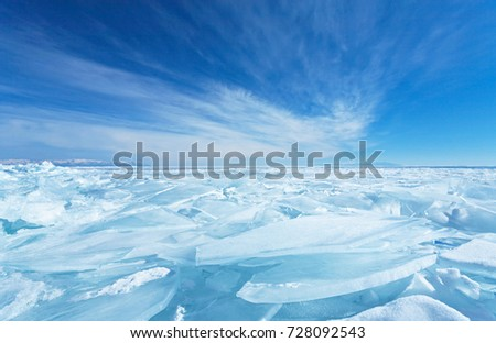 Endless blue ice hummocks in winter on the frozen Lake Baikal