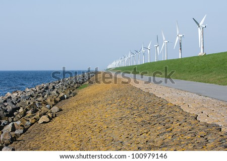 Endless dike with windmills in the Netherlands