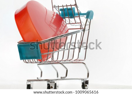 Endless love Valentine's day concept, Red heart in shopping cart, basket supermarket on screen tablet background. Love is passion for romantic couple and Connection, Celebration of world wide to know