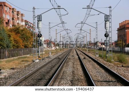 Endless railroad tracks in Valladolid, Spain. Vanishing point phenomenon.