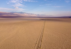 Endless road to horizon through the Death valley. Aerial view on a desert.