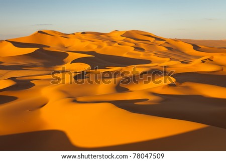Endless sand dunes at sunset - Murzuq Desert, Sahara, Libya