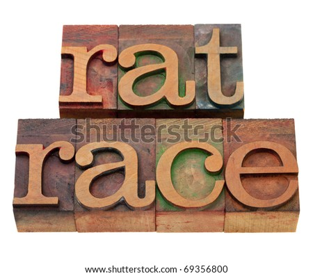 endless, self-defeating or pointless pursuit - rat race phrase in vintage wooden letterpress printing blocks, stained by color inks, isolated on white