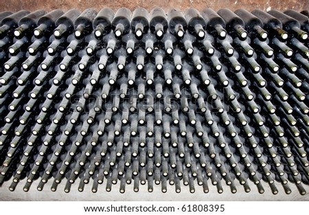 endless stack of wine bottles
