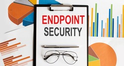 Endpoint Security . Conceptual background with chart ,papers, pen and glasses, business