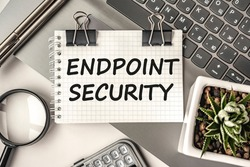 Endpoint security text on a notepad and laptop, office tools. Business, financial concept. remote training. Coffee break, ideas, notes, goals or writing a plan, invitation concept. Top view, flat lay.