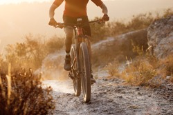 Enduro cycling rider during sunset in the mountain, active lifestyle