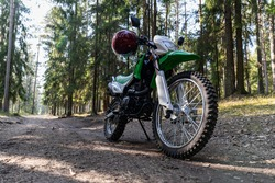 Enduro motorcycle parked in the forest, IRBIS TTR, concept, active lifestyle, enduro, off-road, the rays of the sun, background for the screen