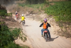 Enduro motorcycles are riding on sand