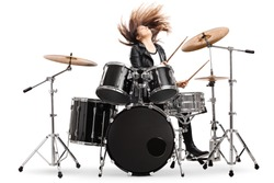 Energetic female drummer throwing her hair and playing drums isolated on white background