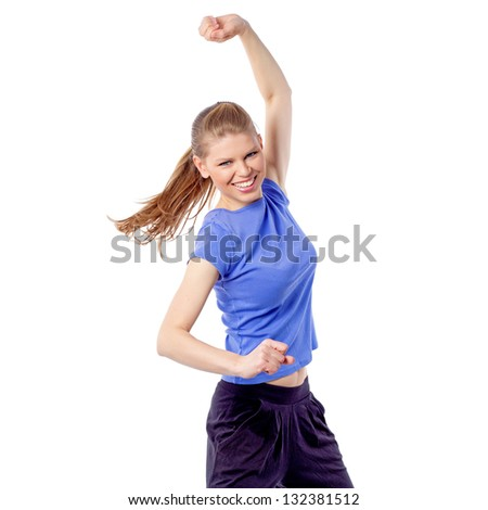 Energetic fitness woman exercising latin aerobics dance. Beautiful Caucasian model dancing with disheveled hair and hand raised. Healthy and fresh, weight loss concept. Isolated on white