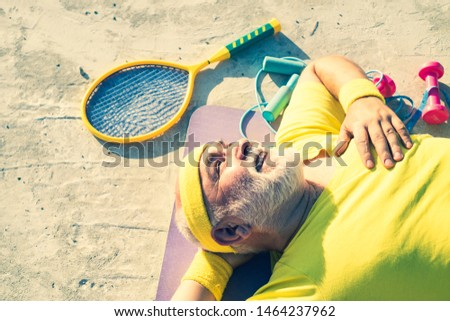 Energetic for elderly sportsmen. Happy active old man holding exercise mat. Grandfather sportsman. Fit senior man resting after working out. Like sports