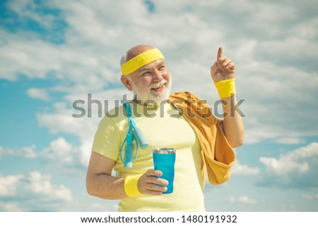 Energetic for senior sportsmen. Senior male is enjoying sporty lifestyle. Sporting. Funny sporty old sportsman finished his work out. Freedom retirement concept. Grandfather sportsman