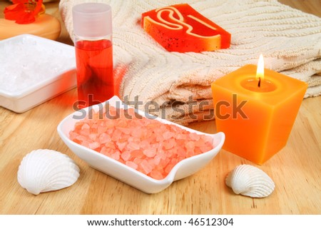Energetic orange spa therapy composition  - candle, salt crystals and seashells