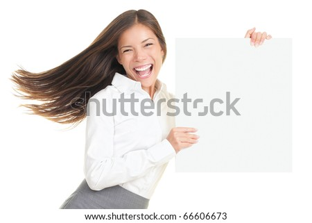 Energetic portrait of young businesswoman holding a blank empty poster with copy space. Beautiful young smiling woman isolated on white background.