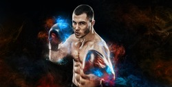 Energy and power boxing concept. Sportsman muay thai boxer fighting in gloves Isolated on black background.