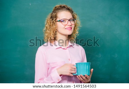 Energy charge for whole day. Coffee addicted. Dose of caffeine. Teacher in glasses drink coffee chalkboard background. Teaching is greatest act of optimism. Woman enjoy coffee before school classes.