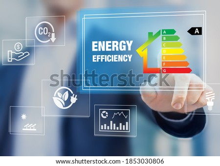 Energy efficiency rating and eco home renovation insulation performance, low consumption ecological house, sustainable development concept with expert touching icon on screen Foto stock ©