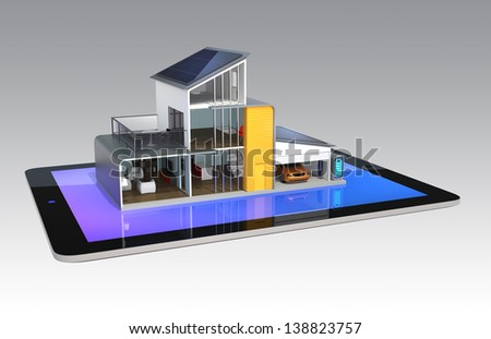 Energy efficient house with smart tablet management - stock photo