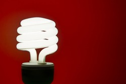 Energy efficient light bulb with red wall