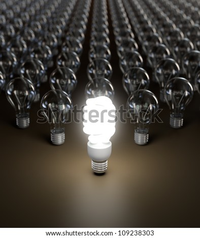 Energy saving and simple light bulbs isolated on brown background.