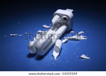 energy saving bulb broken into pieces