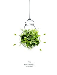 Energy saving eco lamp, made with green sprout and leaves,isolated on white background. LED lamp with green leaf. Minimal nature concept.Think Green.Ecology Concept. Environmentally friendly planet.