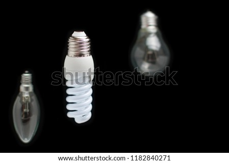 Energy saving fluorescent bulb innovation concept green technology and old simple Incandescent lamps.