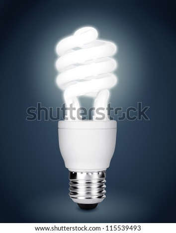 Energy saving fluorescent light bulb isolated on dark background. Clipping path included.
