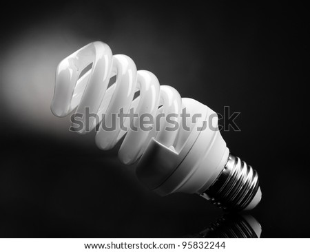 Energy saving lamp on black background