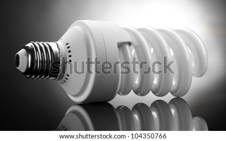 Energy saving lamp on grey background