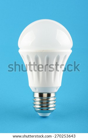 Energy saving LED lighting lamp on the blue background