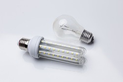 Energy-saving light bulb and classic incandescent bulb with high energy consumption; Ecology versus pollution and energy waste