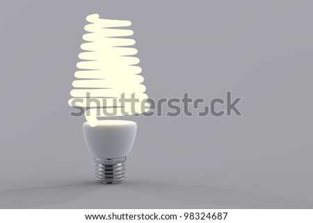 Energy saving light bulb close up in studio.
