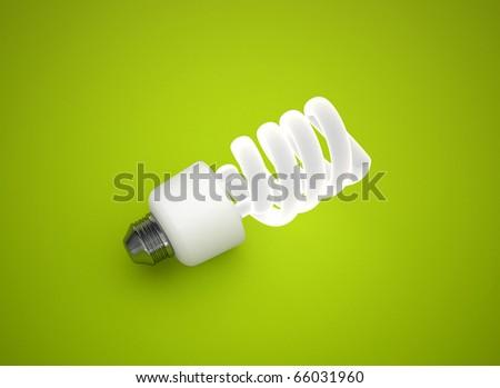 energy saving light bulb on green background