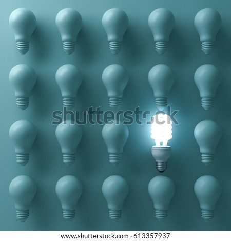 Energy saving light bulb , one glowing compact fluorescent lightbulb standing out from unlit incandescent bulbs on green background , individuality and different creative idea concepts . 3D rendering.