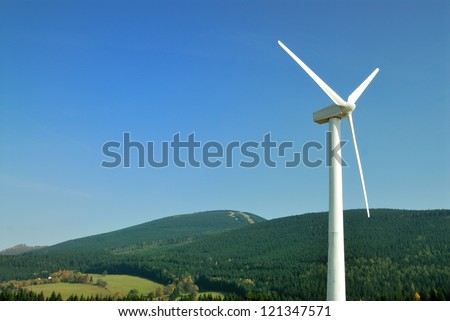 Energy wind turbine at mountain background