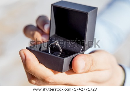 Engagement ring for romantic outdoor elopement marriage proposal when man proposing and holding up an engagement ring in box  Stock photo ©