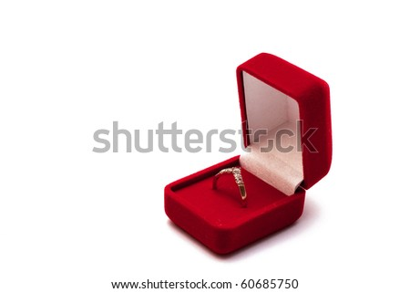 Engagement ring in an open red box isolated on white