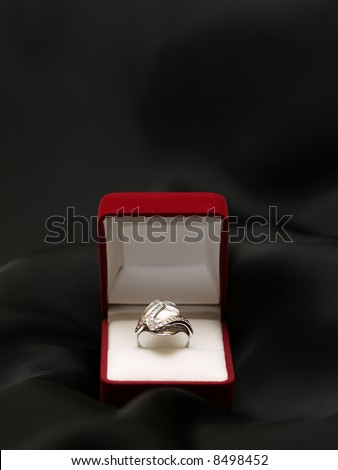 engagement ring in red box on black background isolated
