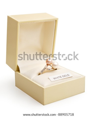 Engagement ring of white gold and pearls in an elegant jewlry box.