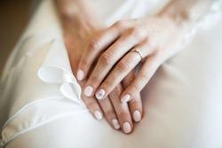 Engagement ring on bride's finger. Wedding day.