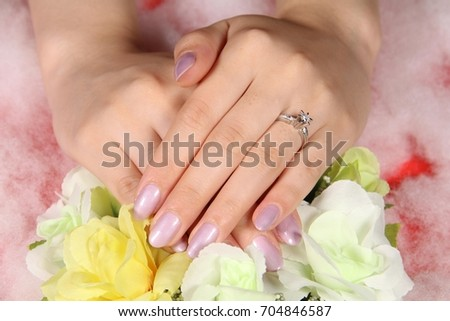 Engagement ring on woman's hand  #704846587