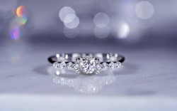 Engagement wedding diamond ring . isolated on mable.