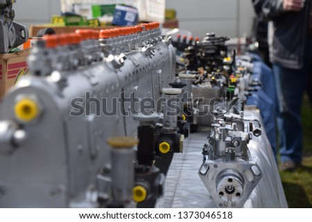 Engine and engine parts in a workshop